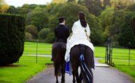 A bridge & groom on horseback