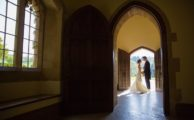 A couple photographed through a doorway