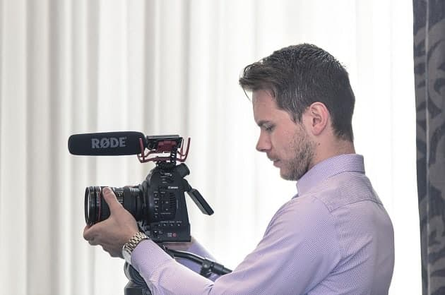 Man adjusting a camera