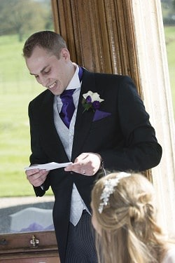 A groom reading his wedding speech
