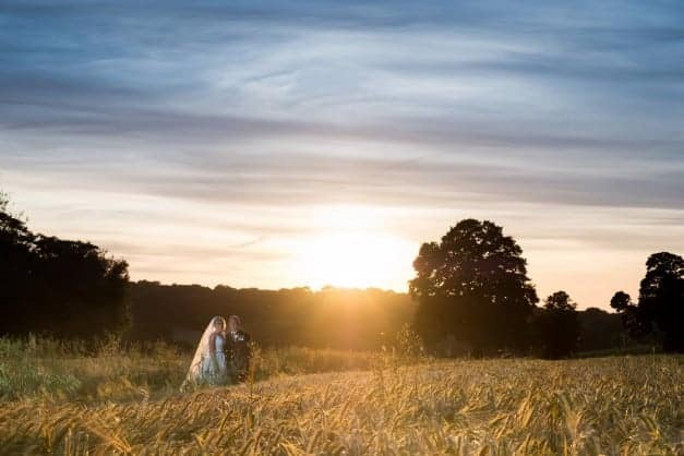sunset landscape picture with bride & groom